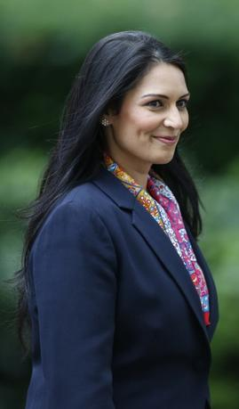 Britain's new International Development Secretary, Priti Patel, leaves Number 10 Downing Street in London, Britain July 14, 2016.    REUTERS/Paul Hackett
