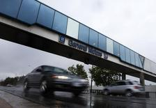 Cars pass under an overpass at the General Motors Car assembly plant in Oshawa, June 1, 2012. REUTERS/Mark Blinch