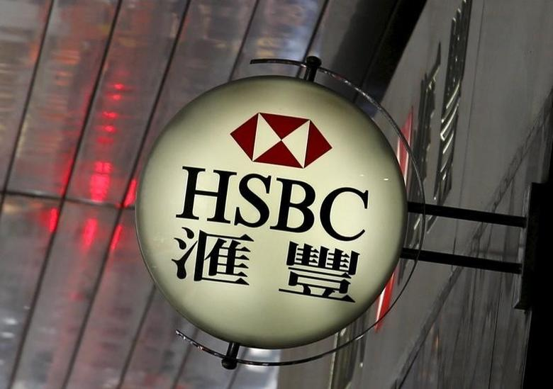 A logo of HSBC is displayed outside a branch in the financial district in Hong Kong, China, June 2, 2015.  REUTERS/Bobby Yip/File Photo