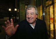 British comedian Terry Jones smiles as he leaves The Rolls Building in central London November 30, 2012.  REUTERS/Suzanne Plunkett/File Photo
