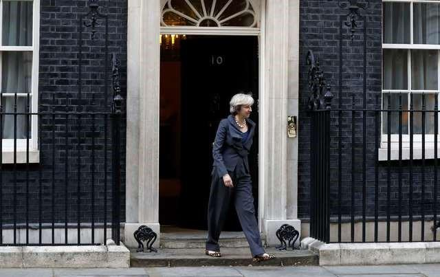 Britain's Prime Minister Theresa May walks out of 10 Downing street to greet the President of the European Parliament Martin Schultz (not shown) in London, September 22, 2016.  REUTERS/Stefan Wermuth