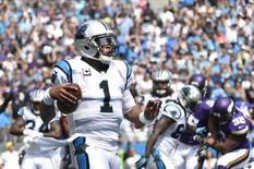 Sep 25, 2016; Charlotte, NC, USA;  Carolina Panthers quarterback Cam Newton (1) scores a touchdown in the first quarter at Bank of America Stadium. Mandatory Credit: Bob Donnan-USA TODAY Sports