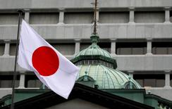 A Japanese flag flutters atop the Bank of Japan building in Tokyo, Japan, September 21, 2016.  REUTERS/Toru Hanai