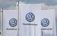 Flags of German car maker Volkswagen are seen at the IAA truck show in Hanover, September 22,  2016.  REUTERS/Fabian Bimmer