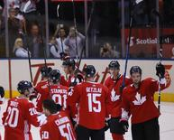 Sep 24, 2016; Toronto, Ontario, Canada; Team Canada salutes the fans after a victory over Team Russia during a semifinal game in the 2016 World Cup of Hockey at Air Canada Centre. Canada defeated Russia 5-3. Mandatory Credit: John E. Sokolowski-USA TODAY Sports