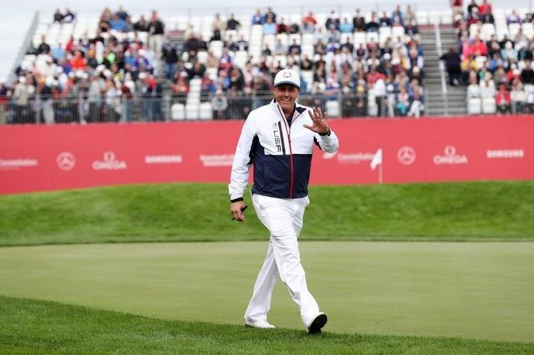Sep 28, 2016; Chaska, MN, USA;  Phil Mickelson walks on the course during the practice round for the Ryder Cup at Hazeltine National Golf Club. Mandatory Credit: Rob Schumacher-USA TODAY Sports - RTSPXEK