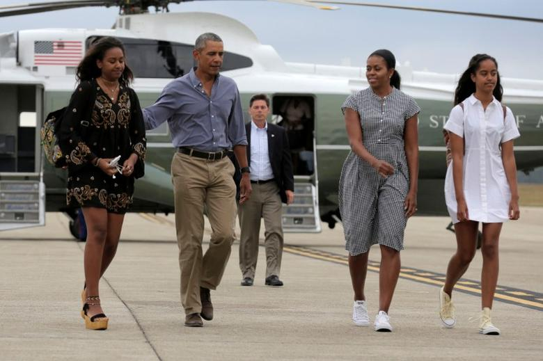U.S. President Barack Obama, U.S. first lady Michelle Obama and their daughters Malia (R) and Sasha (L) board Air Force One at Cape Cod Coast Guard Air Station in Buzzards Bay, Massachusetts, U.S., August 21, 2016. REUTERS/Joshua Roberts