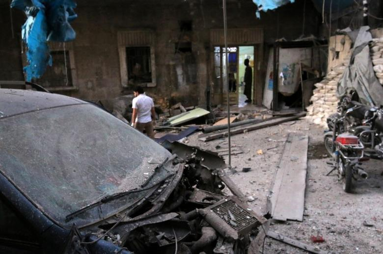 Medics inspect the damage outside a field hospital after an airstrike in the rebel-held al-Maadi neighbourhood of Aleppo, Syria, September 28, 2016. REUTERS/Abdalrhman Ismail