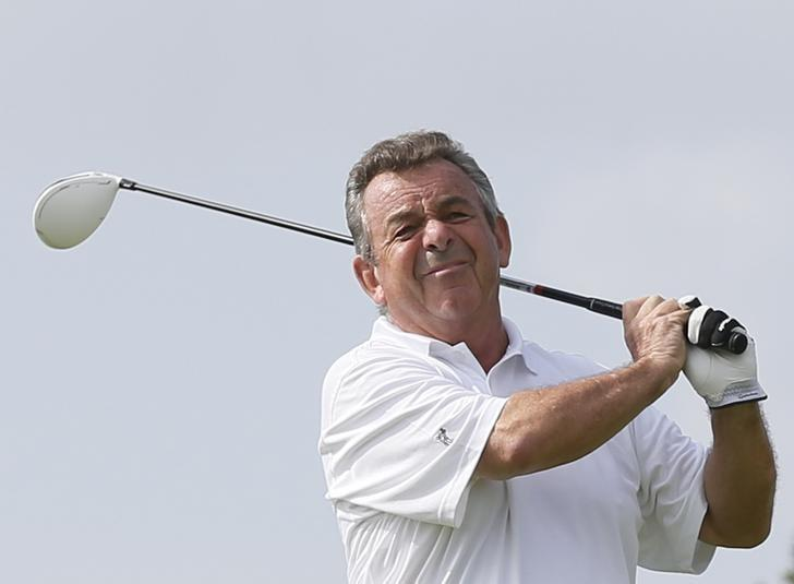 Tony Jacklin of England tees off on the first hole during the first round of the Mission Hills World Celebrity Pro-Am golf tournament in Haikou, China's Hainan province October 20, 2012. REUTERS/Tyrone Siu