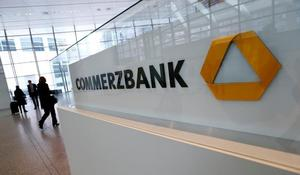 Visitors arrive at Commerzbank's headquarters before the bank's annual news...