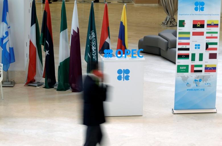 A man walks past an OPEC logo ahead of an informal meeting between members of the Organization of the Petroleum Exporting Countries (OPEC) in Algiers, Algeria September 28, 2016. REUTERS/Ramzi Boudina