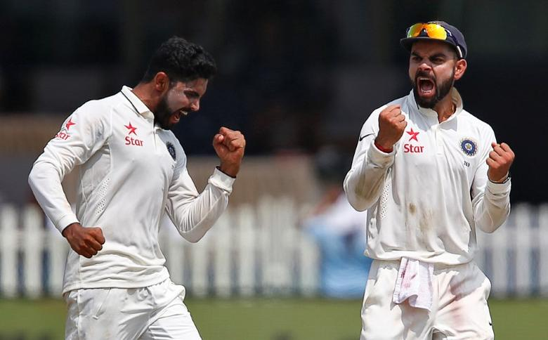 Cricket - India v New Zealand - First Test cricket match - Green Park Stadium, Kanpur, India - 24/09/2016. India's Ravindra Jadeja (L) celebrates with Virat Kohli after taking the wicket of New Zealand's Luke Ronchi. REUTERS/Danish Siddiqui