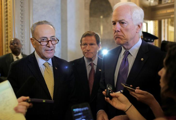 Senators Chuck Schumer (D-NY) (L), Richard Blumenthal (D-CT), and John Cornyn (R-TX), speak after the Senate voted to override U.S. President Barack Obama's veto of a bill that would allow lawsuits against Saudi Arabia's government over the Sept. 11 attacks, on Capitol Hill in Washington, U.S., September 28, 2016. REUTERS/Joshua Roberts