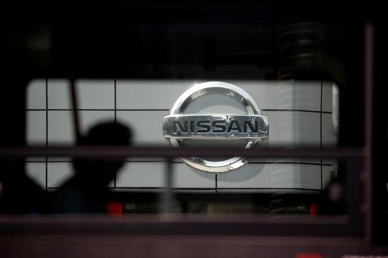 The logo of Nissan is seen through a window of a bus passing by its dealership in Seoul, South Korea, May 16, 2016.  REUTERS/Kim Hong-Ji/File Photo