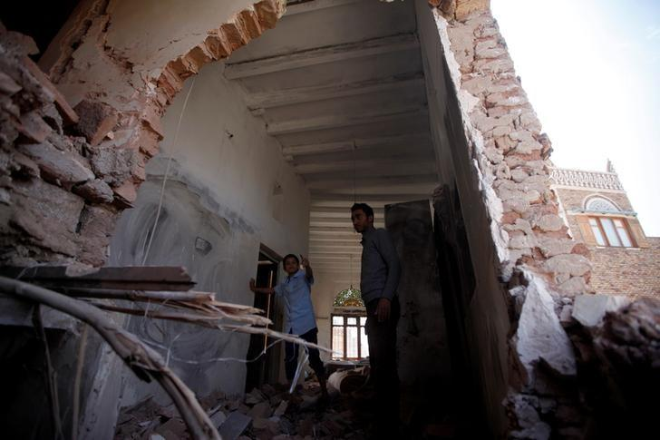 A man inspects a damaged house destroyed by a Saudi-led air strike in old Sanaa city, Yemen, September 24, 2016. REUTERS/Mohamed al-Sayaghi