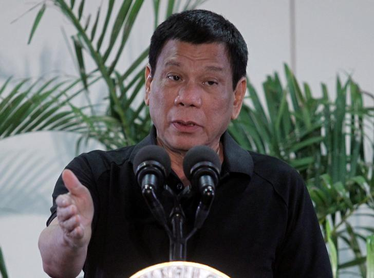 Philippines President Rodrigo Duterte gestures during a news conference upon his arrival from a state visit in Vietnam at the International Airport in Davao city, Philippines September 30, 2016. REUTERS/Lean Daval Jr