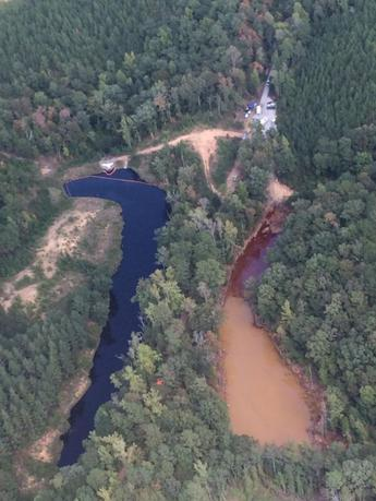 An aerial photo of a man-made mine retention basin Pond 2 (R) and Pond 3 seen in a picture taken September 19, 2016 in Shelby County, Alabama and provided by the Colonial Pipeline Company. Gasoline which spilled from a pipeline leak is contained to retention area Pond 2 and skimming operations continue.   Colonial Pipeline Company/Handout via Reuters