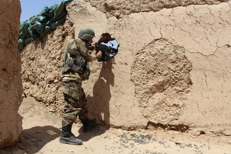 An Afghan National Army (ANA) soldier mans his position at an outpost in Babaji area of Lashkar Gah Helmand province, Afghanistan May 8, 2016. REUTERS/Abdul Malik/Files