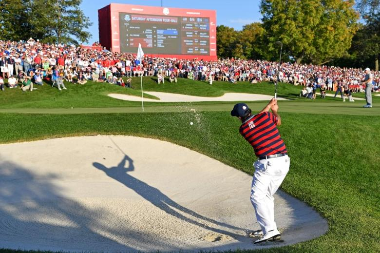 Oct 1, 2016; Chaska, MN, USA;  Phil Mickelson of the United States plays a shot from a bunker on the 16th hole during the afternoon four-ball matches in the 41st Ryder Cup at Hazeltine National Golf Club. Mandatory Credit: Michael Madrid-USA TODAY Sports