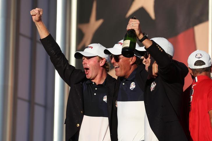 Oct 2, 2016; Chaska, MN, USA;  Brandt Snedeker of the United States,  Phil Mickelson of the United States and  Zach Johnson of the United States celebrate during the closing ceremonies after the single matches in 41st Ryder Cup at Hazeltine National Golf Club. Mandatory Credit: Rob Schumacher-USA TODAY Sports