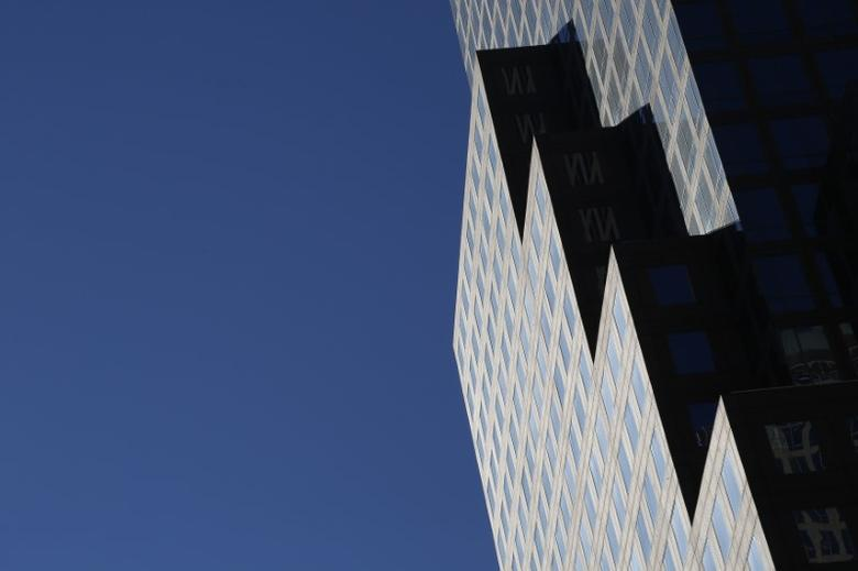 Shadows from the sun enhance the geometrical design on the facade of a skyscraper on a autumn day in New York November 10, 2014.  REUTERS/John Schults