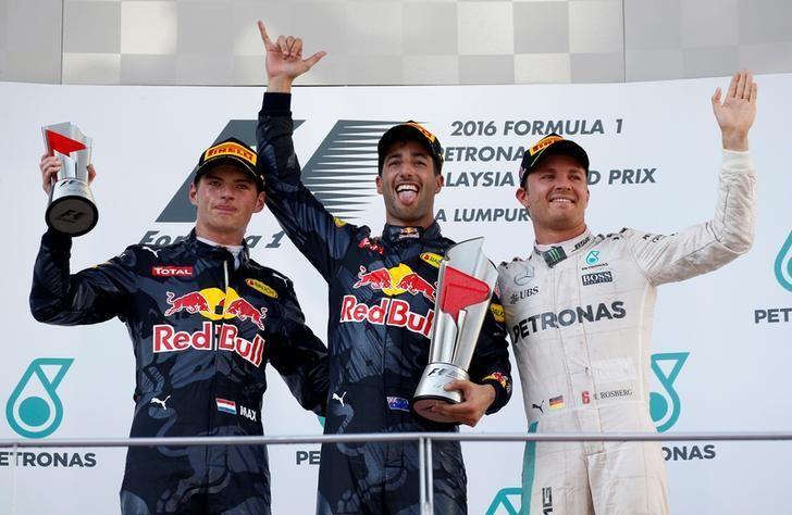 Formula One - F1 - Malaysia Grand Prix - Sepang, Malaysia- 2/10/16  Red Bull's Daniel Ricciardo of Australia (C), Red Bull's Max Verstappen of the Netherlands and Mercedes' Nico Rosberg of Germany celebrate on the podium. REUTERS/Edgar Su
