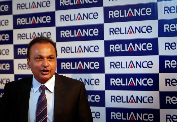 Anil Ambani, chairman of the Reliance Anil Dhirubhai Ambani Group, poses for photographers before addressing the annual shareholders meeting in Mumbai August 27, 2013. REUTERS/Danish Siddiqui/File Photo