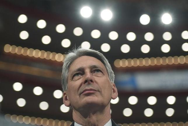 10月3日、ハモンド英財務相(写真)は、英国のEU離脱決定を受けた経済の混乱を収束させる新たな財政計画が必要との見方を示した。バーミンガムで2日撮影(2016年 ロイター/Toby Melville)