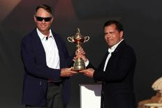 Oct 2, 2016; Chaska, MN, USA; Team USA captain Davis Love III is presented the Ryder Cup by PGA of America president Derek Sprague during the closing ceremonies after the single matches in 41st Ryder Cup at Hazeltine National Golf Club. Mandatory Credit: Rob Schumacher-USA TODAY Sports