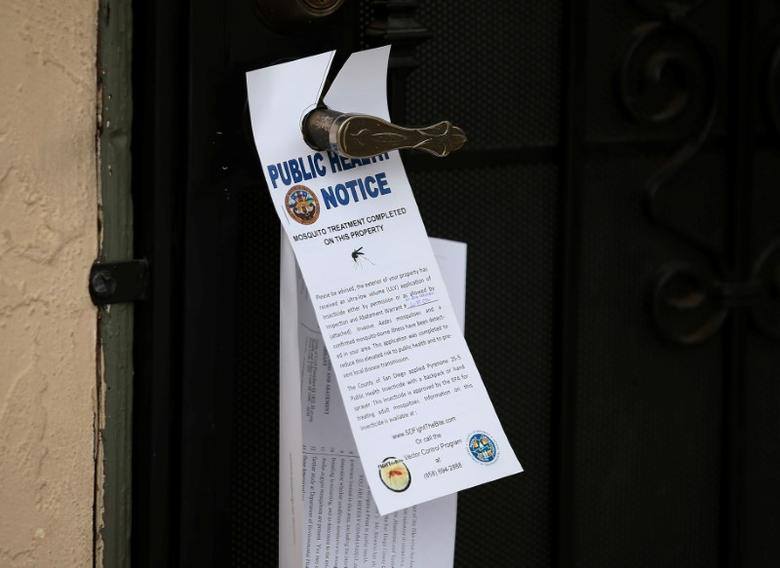 County vector control leave information on door handles as they hand-spraying a neighborhood for adult Aedes mosquitoes after a travel-related case of Zika was confirmed in this the area of San Diego, California, U.S. September 12, 2016. REUTERS/Mike Blake