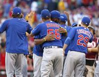 Chicago Cubs relief pitcher Hector Rondon (56) hugs right fielder Jason Heyward (22) after defeating the Cincinnati Reds 7-4 at Great American Ball Park. Mandatory Credit: David Kohl-USA TODAY Sports