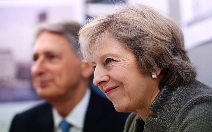 Prime Minister Theresa May and Chancellor of the Exchequer Philip Hammond during a visit to a construction site in Birmingham, where new HSBC offices are being built, Britain October 3, 2016. REUTERS/Stefan Rousseau/Pool