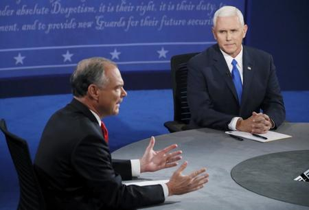 Republican U.S. vice presidential nominee Governor Mike Pence looks on as Democratic U.S. vice presidential nominee Senator Tim Kaine speaks during their vice presidential debate at Longwood University in Farmville, Virginia, U.S., October 4, 2016.