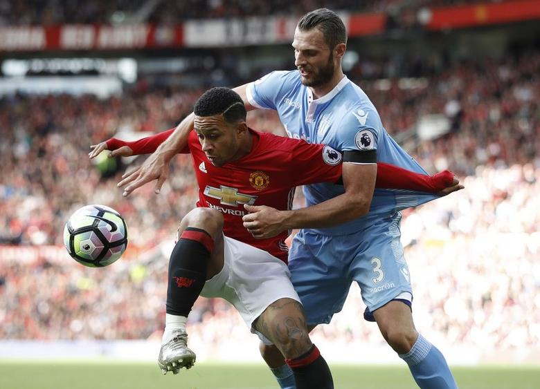 Britain Soccer Football - Manchester United v Stoke City - Premier League - Old Trafford - 2/10/16Stoke City's Erik Pieters in action with Manchester United's Memphis Depay Action Images via Reuters / Carl RecineLivepic