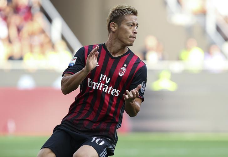 Football Soccer - AC Milan v Udinese - Italian Serie A - San Siro stadium, Milan, Italy - 11/09/16 AC Milan's  Keisuke Honda reacts against Udinese.  REUTERS/Stefano Rellandini