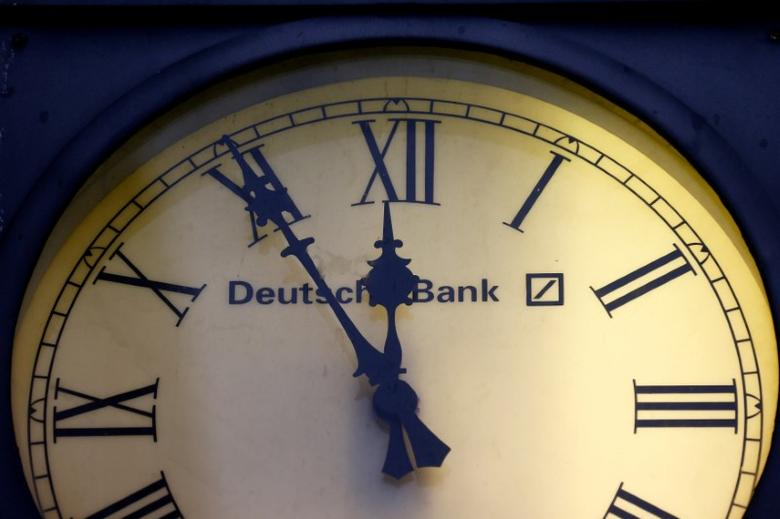 A vintage clock with the logo of Deutsche Bank is pictured outside the bank's branch in Wiesbaden, Germany, January 28, 2015.  REUTERS/Kai Pfaffenbach/File Photo