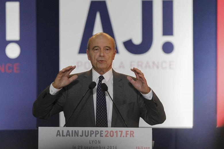 French politician Alain Juppe, current mayor of Bordeaux, a member of the conservative Les Republicains political party and candidate for their presidential primary, attends a rally as he campaigns in Lyon, France, September 29, 2016.    REUTERS/Emmanuel Foudrot