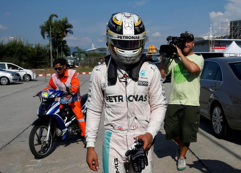 Formula One - F1 - Malaysia Grand Prix - Sepang, Malaysia- 2/10/16 Mercedes' Lewis Hamilton of Britain returns to the paddock after his car caught fire during the race. REUTERS/Edgar Su/File Photo