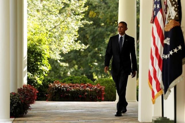 10月6日、オバマ米大統領は英エコノミスト誌に寄稿し、米国は他の国々と協力して強い経済をつくる必要があると強調した。ホワイトハウスで5日撮影(2016年 ロイター/Yuri Gripas)