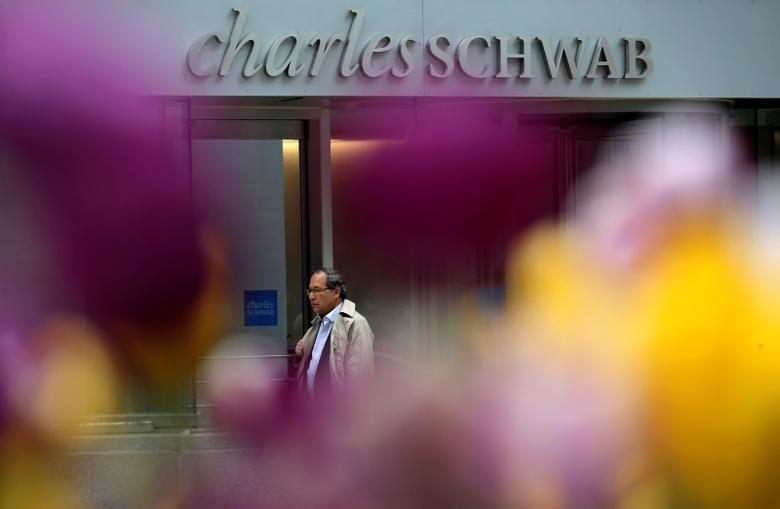 A man walks past a Charles Schwab investment branch in Chicago, Illinois, United States, May 11, 2016. REUTERS/Jim Young