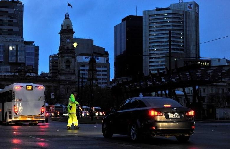 Police direct traffic in the central business district (CBD) of Adelaide after severe storms and thousands of lightning strikes knocked out power to the entire state of South Australia, September 28, 2016. AAP/David Mariuz/via REUTERS/File Photo