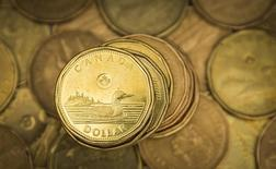 """A Canadian dollar coin, commonly known as the """"Loonie"""", is pictured in this illustration picture taken in Toronto January 23, 2015. T  REUTERS/Mark Blinch"""