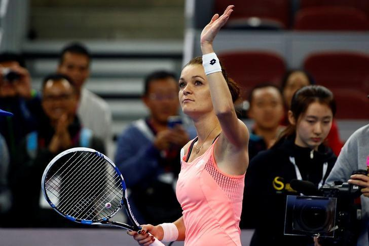 Tennis - China Open Women's Singles quarterfinal - Beijing, China - 08/10/16. Poland's Agnieszka Radwanska celebrates after defeating Kazakhstan's Yaroslava Shvedova. REUTERS/Thomas Peter