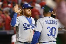 Oct 7, 2016; Washington, DC, USA;Los Angeles Dodgers third baseman Justin Turner (10) celebrates with manager Dave Roberts (30) after defeating the Washington Nationals during game one of the 2016 NLDS playoff baseball series at Nationals Park. The Dodgers won 4-3. Mandatory Credit: Geoff Burke-USA TODAY Sports