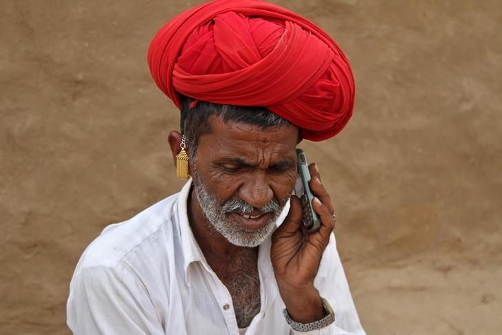 A man talks on his mobile phone in the village of Devmali in Rajasthan, June 14, 2016. REUTERS/Himanshu Sharma/Files