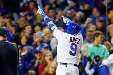 Oct 7, 2016; Chicago, IL, USA; Chicago Cubs second baseman Javier Baez (9) acknowledges the crowd after hitting a home run against the San Francisco Giants during the eighth inning during game one of the 2016 NLDS playoff baseball series at Wrigley Field.  Mandatory Credit: Dennis Wierzbicki-USA TODAY Sports