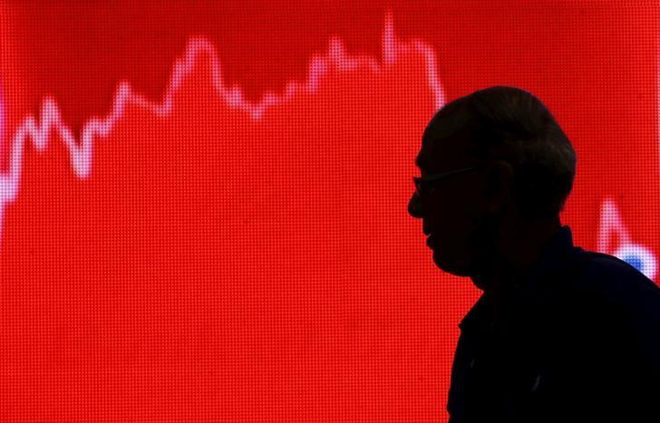 A man looks at a screen displaying news of markets update inside the Bombay Stock Exchange (BSE) building in Mumbai, India, February 11, 2016. REUTERS/Danish Siddiqui/File Photo