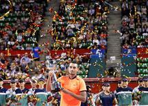 Tennis - Japan Open men's Singles Final Match - Ariake Coliseum, Tokyo, Japan - 09/10/16. Nick Kyrgios of Australia holds his victory trophy. REUTERS/Kim Kyung-Hoon