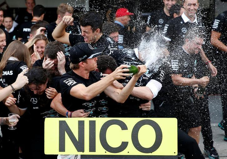 Formula One - Japanese Grand Prix - Suzuka Circuit, Japan- 9/10/16. Mercedes' driver Nico Rosberg of Germany celebrates with team members after they won the Constructors' Championship title for the 2016 season after the race. REUTERS/Toru Hanai