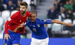 Football Soccer - Italy v Spain - World Cup 2018 Qualifier - Juventus stadium, Turin, Italy - 06/10/16. Italy's Leonardo Bonucci in action against Spain's Gerard Pique.   REUTERS/Stefano Rellandini